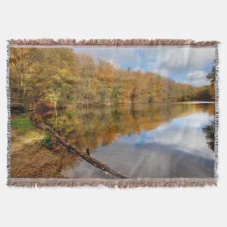 Throw autumnal Fall landscape reflecting water