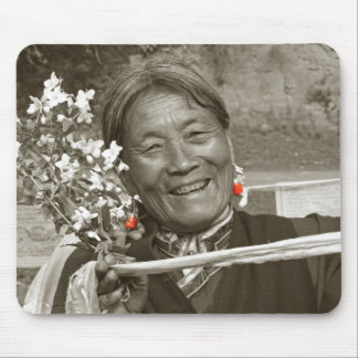 Tibetan woman with flowers and katha mouse pad