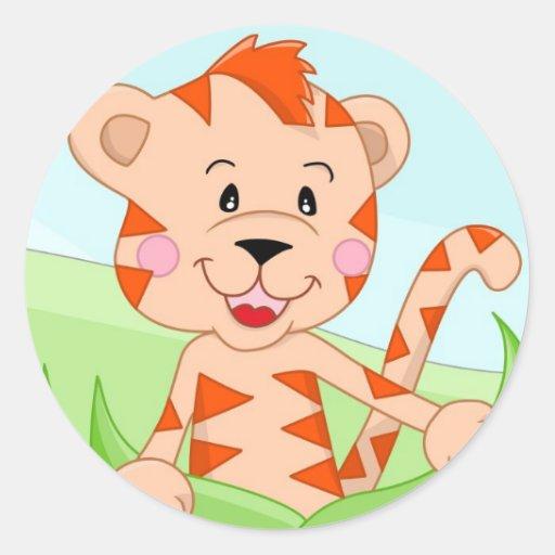 Tiger in grass classic round sticker