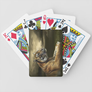 Tiger looking and sitting under dramatic sky bicycle playing cards