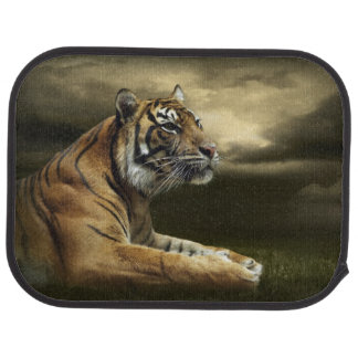 Tiger looking and sitting under dramatic sky car mat