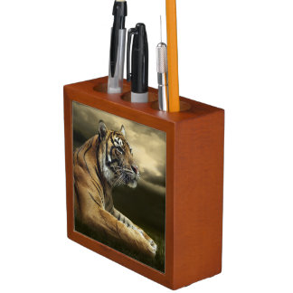 Tiger looking and sitting under dramatic sky desk organiser