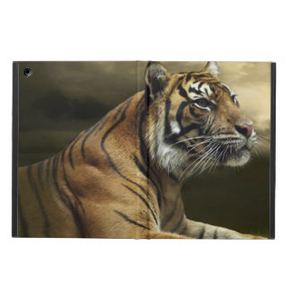 Tiger looking and sitting under dramatic sky iPad air case