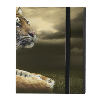 Tiger looking and sitting under dramatic sky iPad folio case