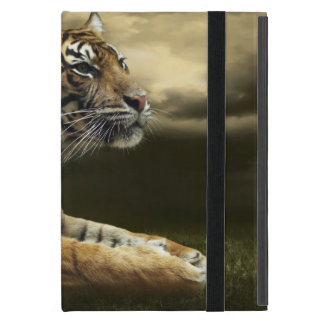 Tiger looking and sitting under dramatic sky iPad mini case