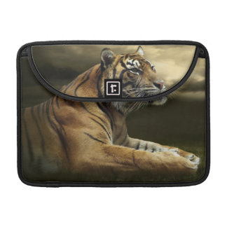 Tiger looking and sitting under dramatic sky sleeve for MacBooks