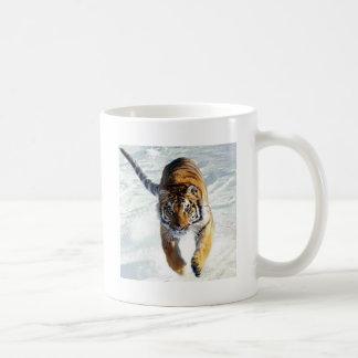 Tiger running in snow coffee mug