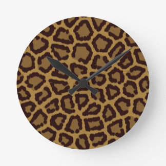 Tile background with a leopard fur round clock