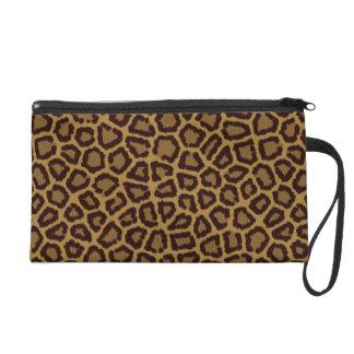 Tile background with a leopard fur wristlet clutches