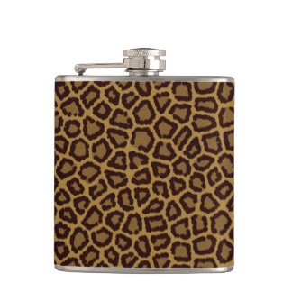 Tile background with a leopard skin print hip flask