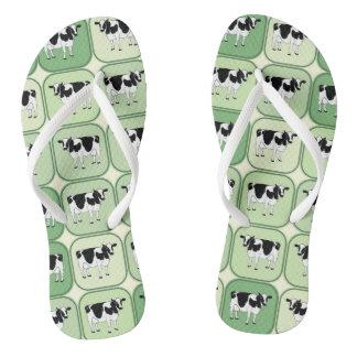 Tiled cows pattern flip flops