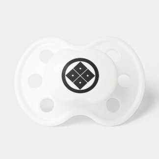 Tilted four-square-eyes in circle baby pacifier