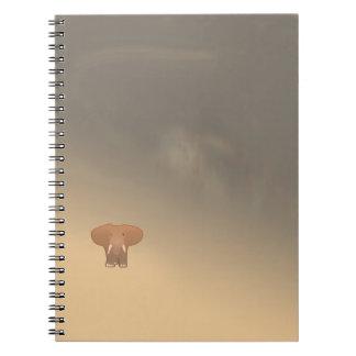 Tiny little elephant in desert notebook