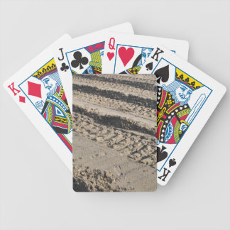 Tire tracks in dirt bicycle playing cards
