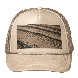 Tire tracks in dirt hat