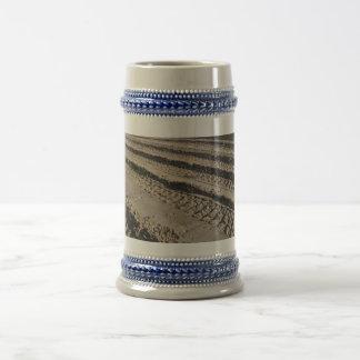 Tire tracks in dirt coffee mug