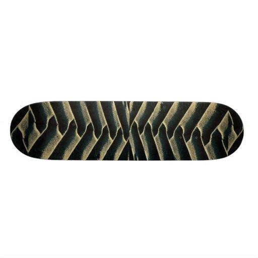 Tire tracks on beach skate decks