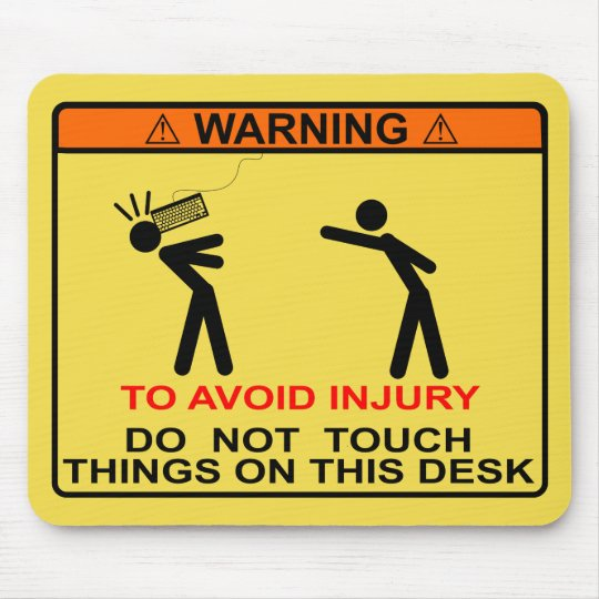 TO AVOID INJURY, DO NOT TOUCH THINGS ON THIS DESK MOUSE MAT