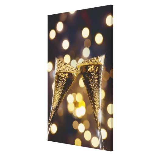 Toasted champagne flute, close-up stretched canvas print