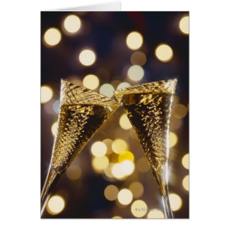Toasted champagne flute, close-up greeting card