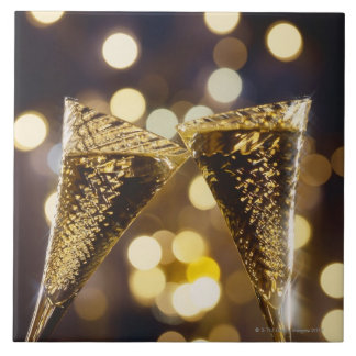Toasted champagne flute, close-up large square tile