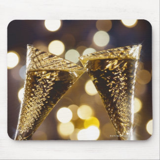 Toasted champagne flute, close-up mouse pad