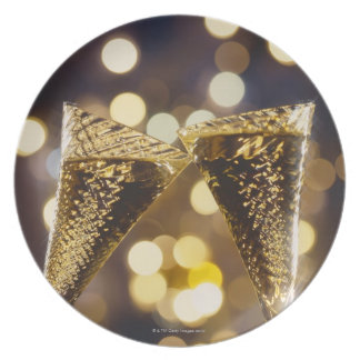 Toasted champagne flute, close-up party plate
