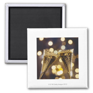 Toasted champagne flute, close-up square magnet