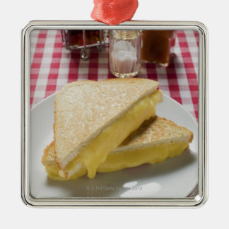 Toasted cheese sandwiches on plate, vinegar, christmas ornament