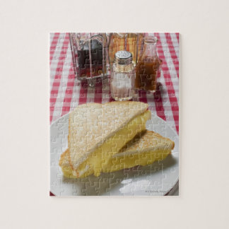 Toasted cheese sandwiches on plate, vinegar, jigsaw puzzle