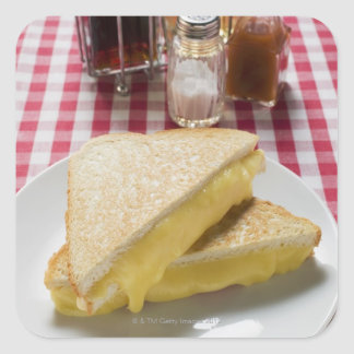 Toasted cheese sandwiches on plate, vinegar, square sticker