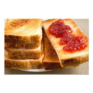 Toasted slices of bread with strawberry jam photo