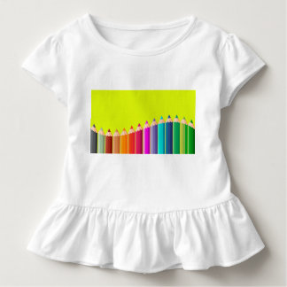 Toddler ruffle tee with color pencils.