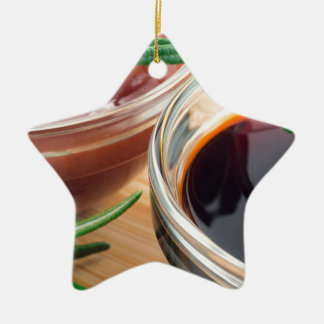 Tomato ketchup and soy sauce in a transparent bowl christmas ornament