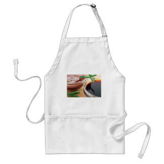 Tomato ketchup and soy sauce in a transparent bowl standard apron
