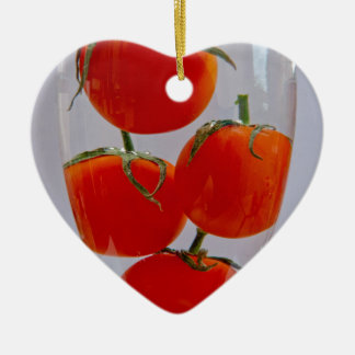Tomatoes in glass of water ceramic heart decoration