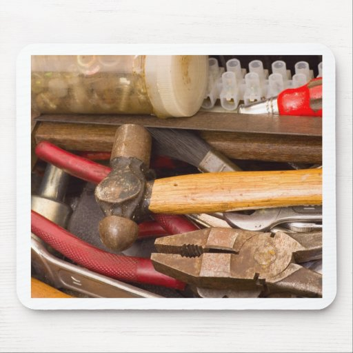 Tools in a messy toolbox mouse pad