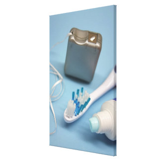 Toothbrush, toothpaste and floss. canvas print