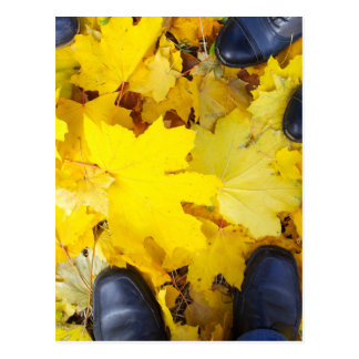 Top view of a foot in the autumn boots three peopl postcard