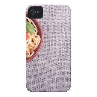 Top view of a gray mat with a spaghetti iPhone 4 covers