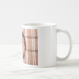 Top view of a thin spaghetti in a brown small wood basic white mug