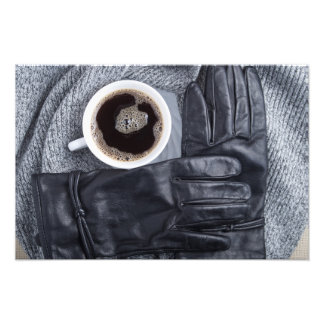 Top view of a white cup of coffee and black gloves photo print
