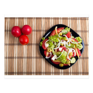 Top view on a vegetable salad with natural postcard