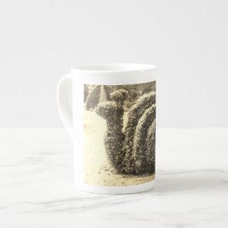 Topiary garden snail ornamental sepia bush tea cup