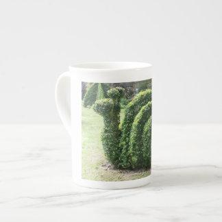 Topiary garden snail trendy clipped bush tea cup