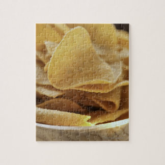 Tortilla chips in wooden bowl jigsaw puzzle