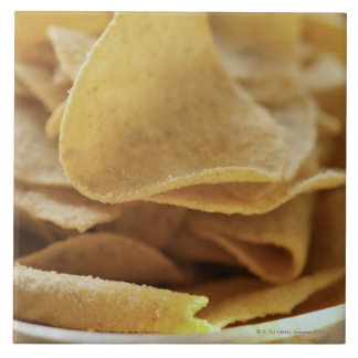 Tortilla chips in wooden bowl tile