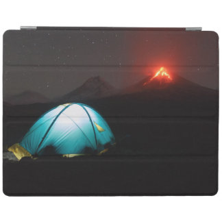 Touristic tent at night on background of volcano iPad cover