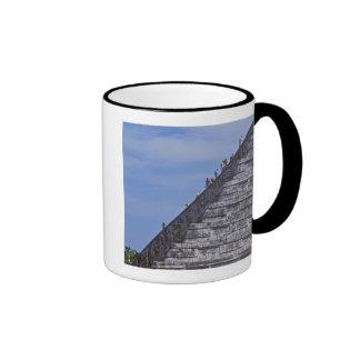 Tourists climbing stairs on ruins of El Mug