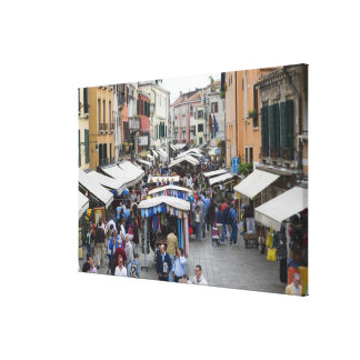 Tourists in a street market, Venice, Italy Canvas Print